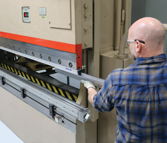 Picture of man inserting new radius tip tooling